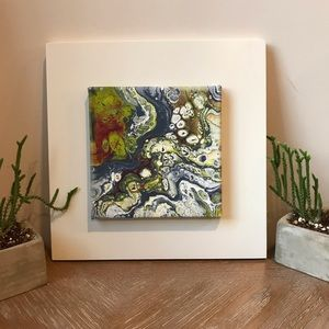 Original piece of abstract art on white frame